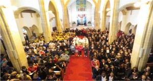 Over 400 pupils squeezed into St Joseph's Church to celebrate this occasion along their Head Teachers, Deputy Heads and members of staff plus Sacred Heart Choir including Year 11, noticeable by their red jumpers. Uniforms: St Josephs - yellow and brown, St Teresa's- blue and white, Sacred Heart - blue blazers and Salvatorian in mufti.