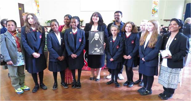Sacred Heart Language College, Wealdstone receives gift from the Pilgrimage Group – Miss Higgins with some pupils and teachers from Bangladesh. (Friday, October 7, 2016)